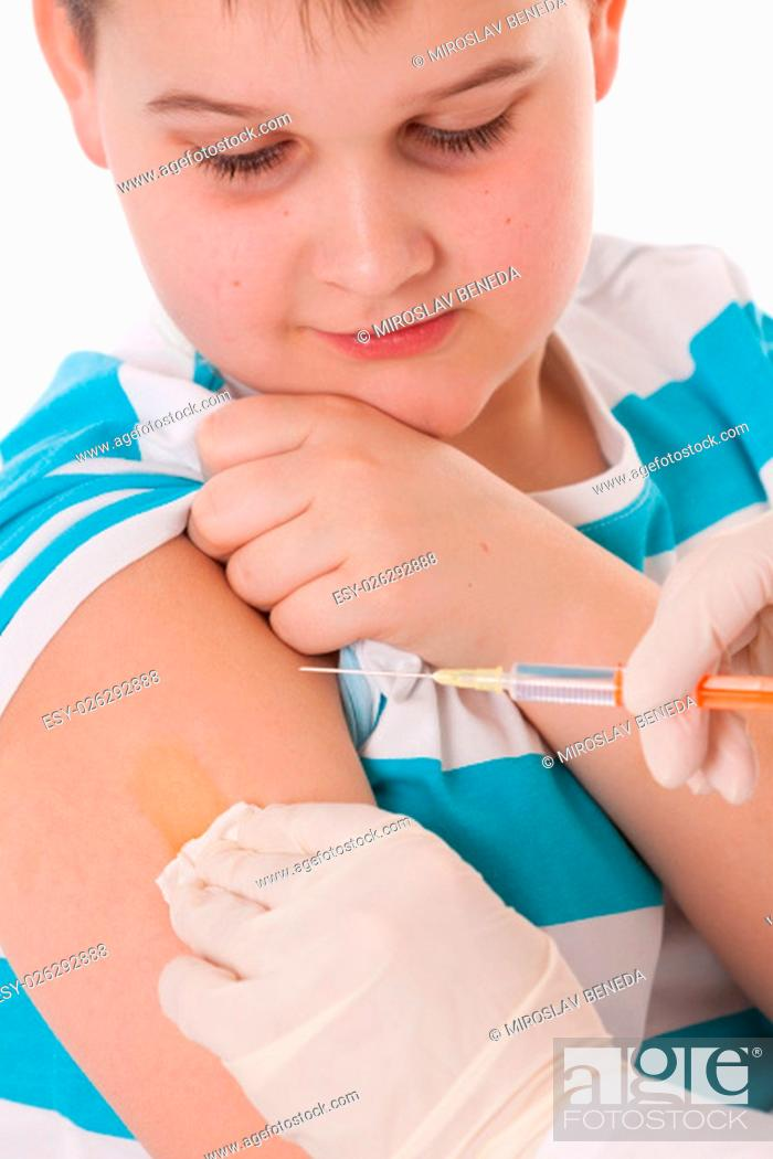Stock Photo: Doctor giving a child injection in arm on isolated image.