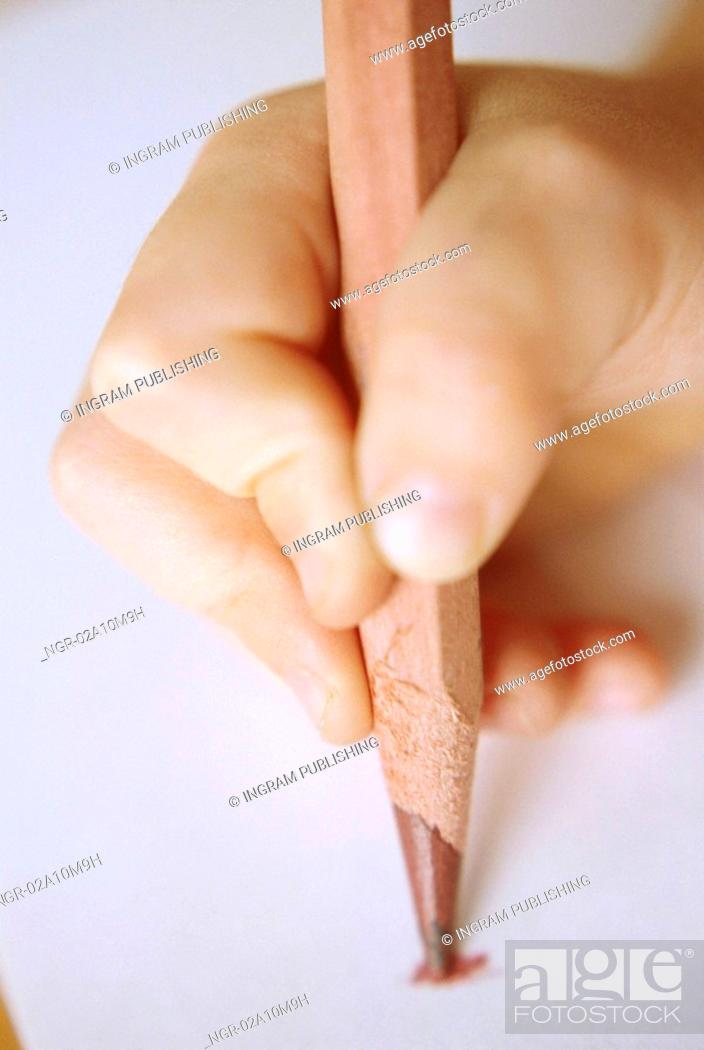 Stock Photo: Child Holding Colored Pencil.