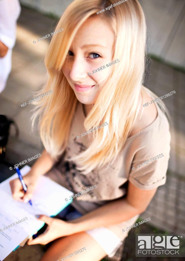 Stock Photo: Teenage girl doing her homework.