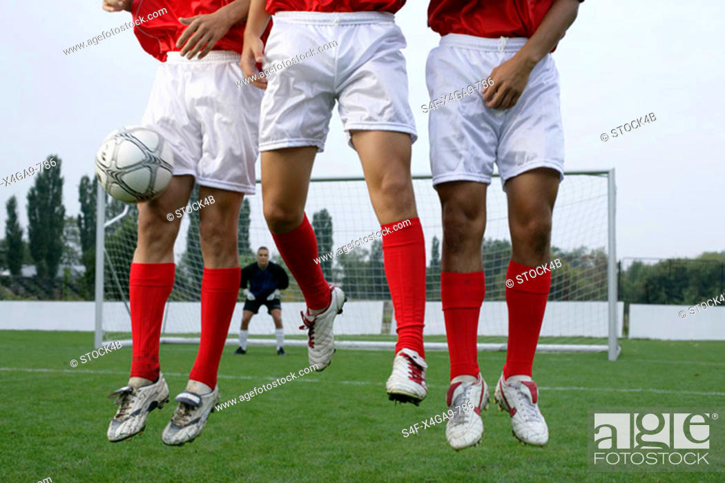 Stock Photo: Soccer players forming a wall.