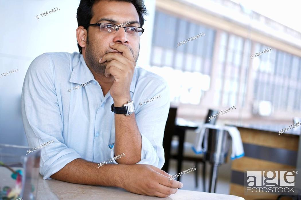 Stock Photo: Contemplative business man.