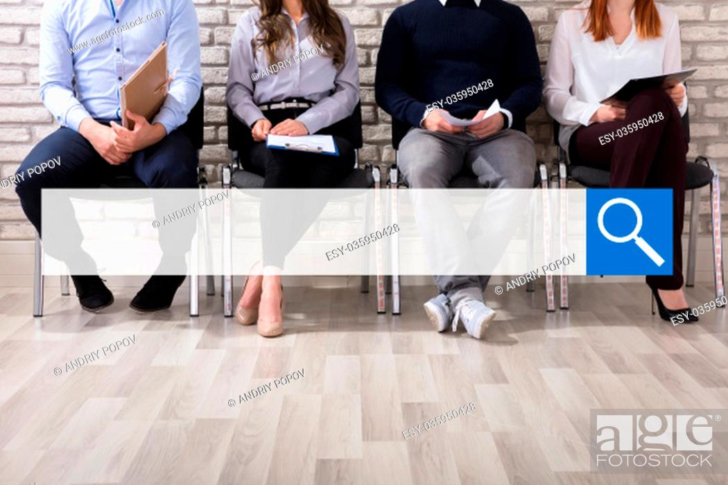 Stock Photo: Close-up Of Business People Sitting On Chair Waiting For Job Interview In Office.