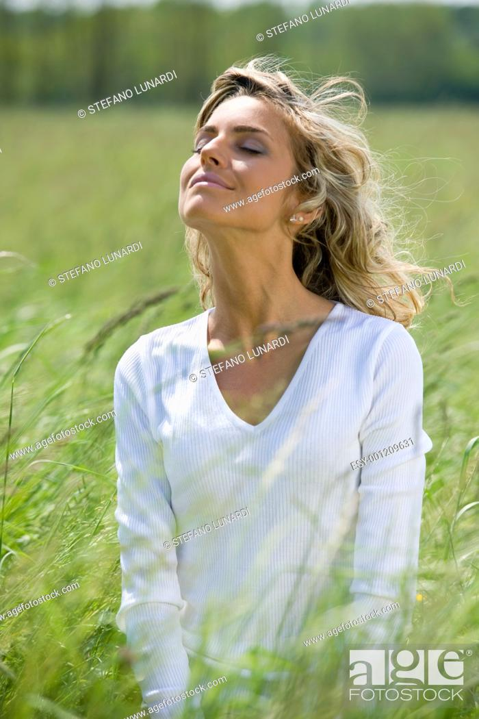 Stock Photo: Beautiful woman enjoying sun and fresh air.