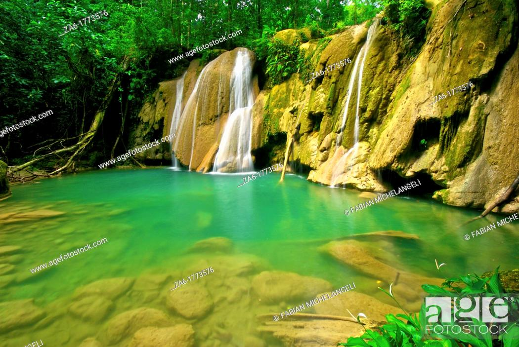 Stock Photo: Waterfall and idyllic emerald pond in Turuépano National Park, Eastern Venezuela.