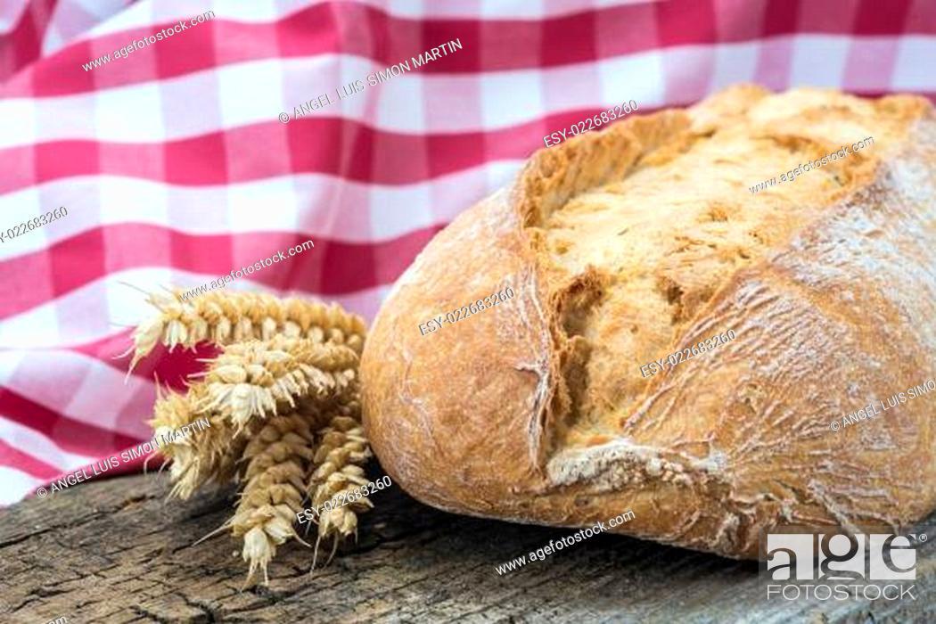 Stock Photo: Wheat bread on a cuttig board.