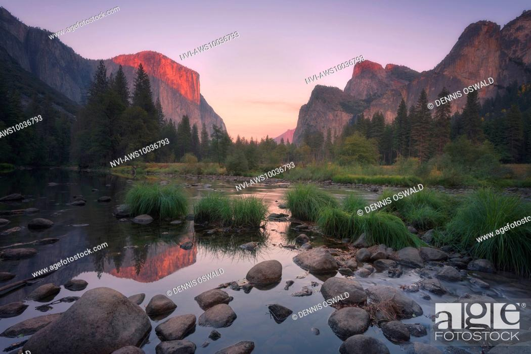 Stock Photo: Yosemite Valley, El Capitan with alpine glow and reflection in Merced River in the Yosemite National Park, California, USA.