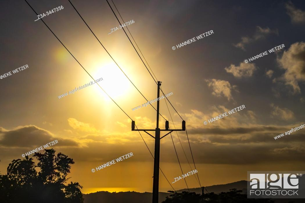 Stock Photo: Sunset and electricity poles in Cuba, Caribbean, Central America.