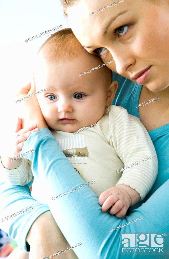 Stock Photo: mum hugging baby.