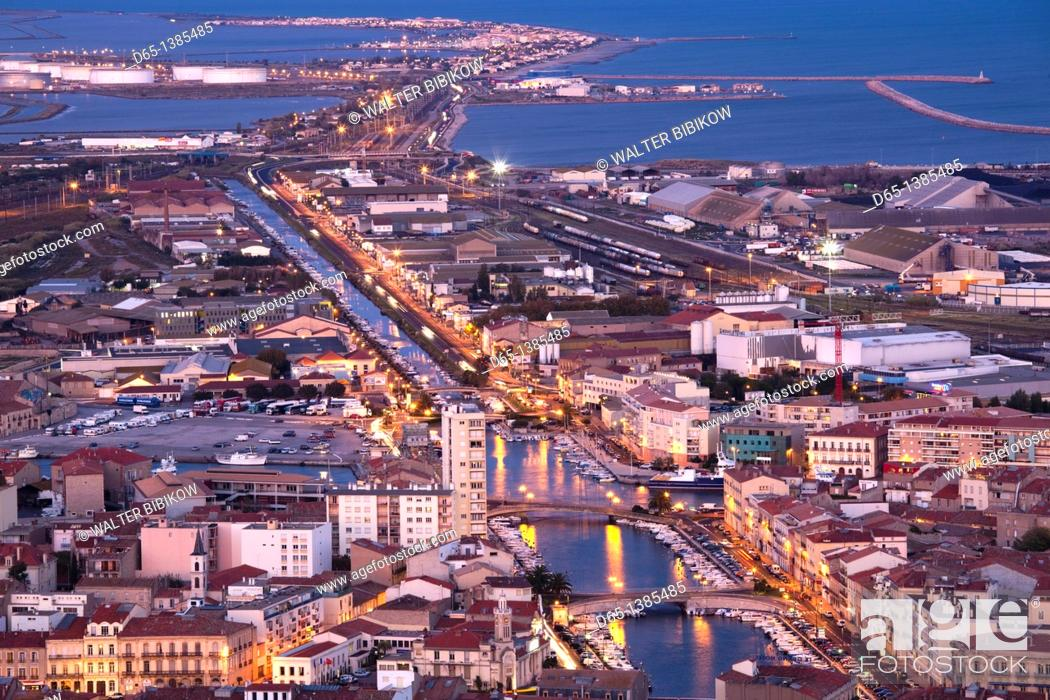 Stock Photo: France, Languedoc-Roussillon, Herault Department, Sete, town overview from Mont St-Clair, dusk.