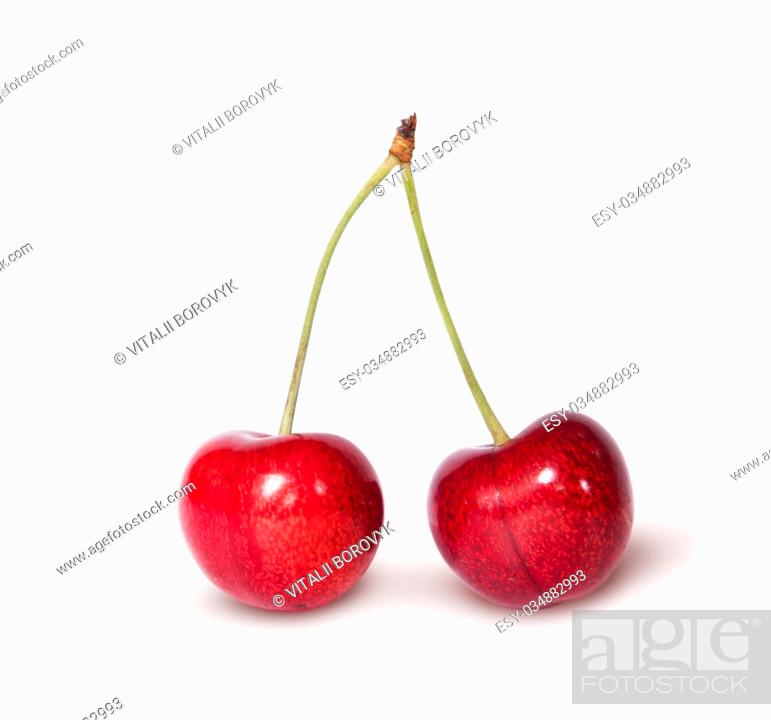 Stock Photo: Two red juicy sweet cherries isolated on white background.
