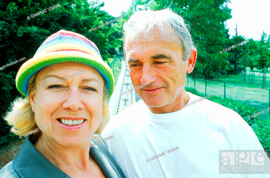 Stock Photo: Portrait of mature couple smiling.