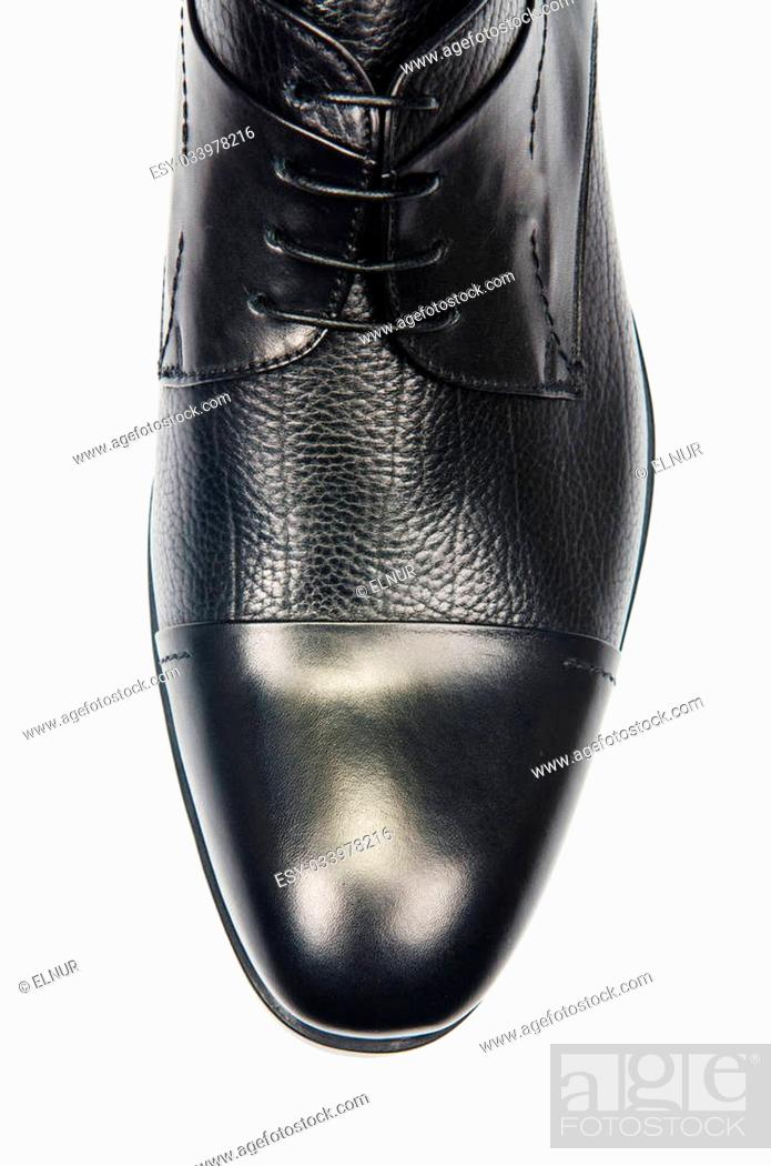 Stock Photo: Tip of male shoes isolated on white.