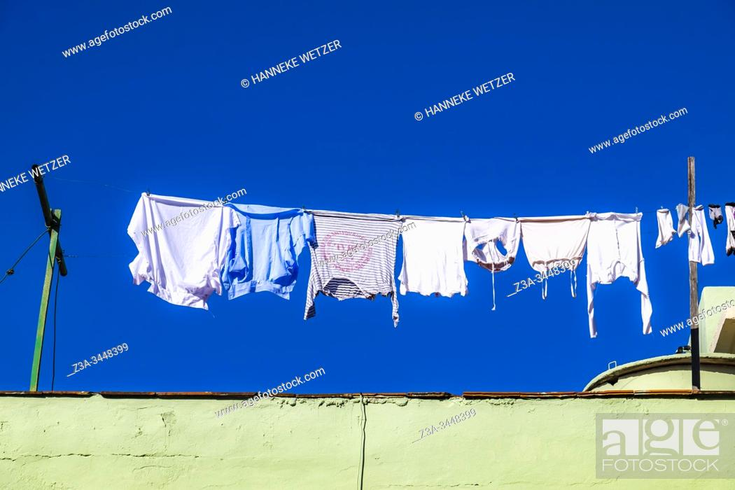 Stock Photo: Laundry hanging to dry in Cienfuegos, Republic of Cuba, Caribbean, Central America.