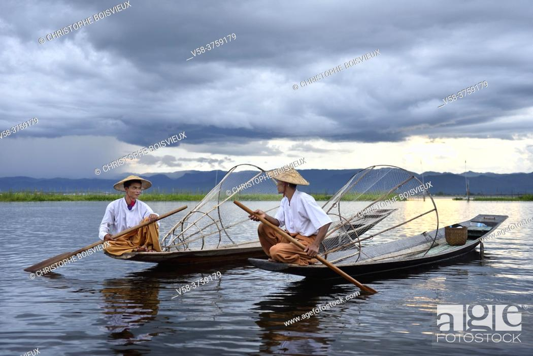 Stock Photo: Myanmar, Shan State, Inle Lake, Intha fishermen and monsoon sky.