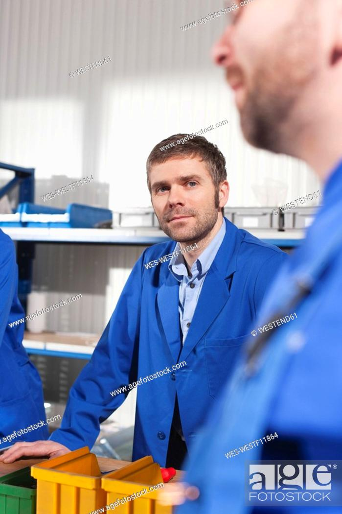 Stock Photo: Germany, Neukirch, Apprentice and instructor.