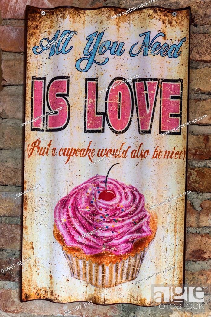 Imagen: Altes Schild mit einem Cupcake.