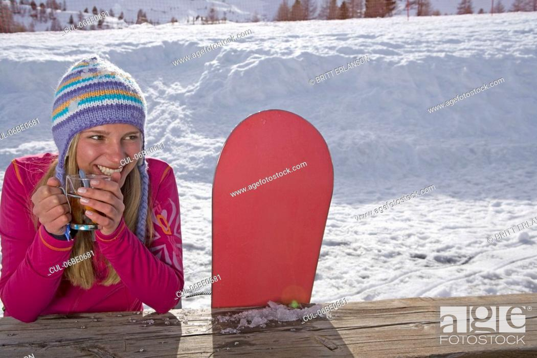 Stock Photo: Girl sitting with ski board.