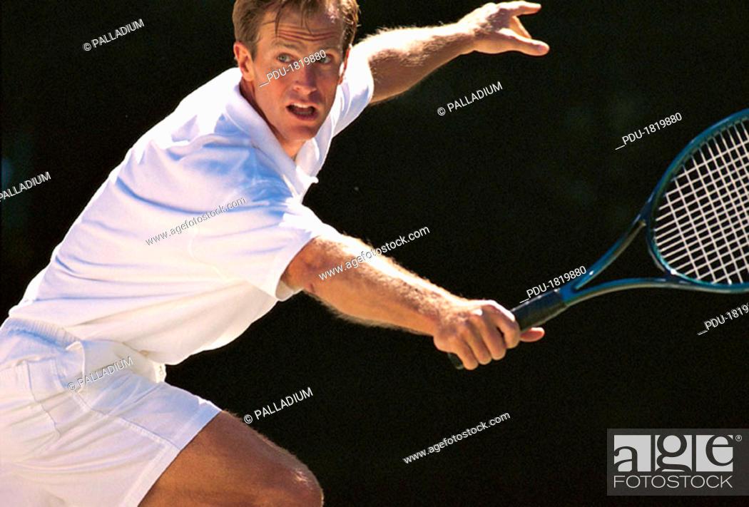 Stock Photo: Man playing tennis.