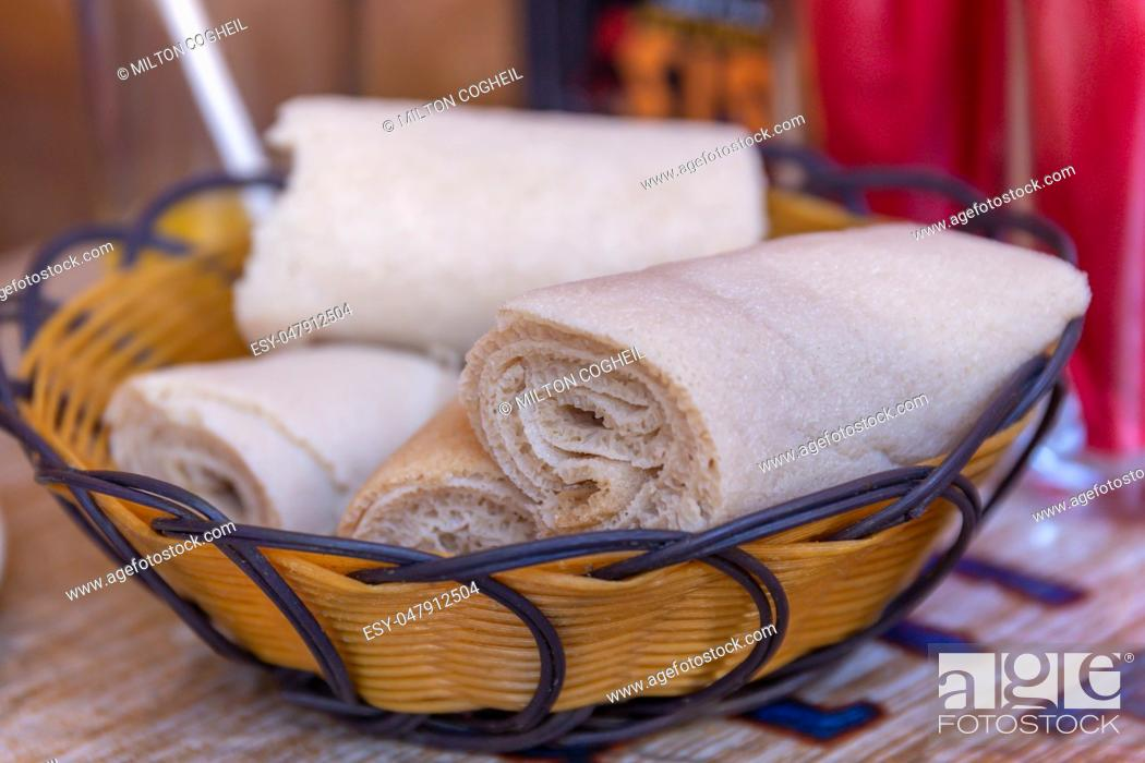 Stock Photo: Rolls of Injera in a serving bowl. Injera is a sourdough flatbread made from teff flour. It is the national dish of Ethiopia, Eritrea, Somalia and Djibouti.