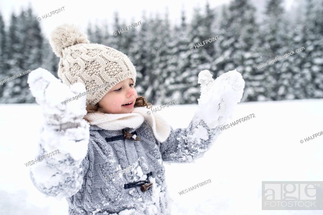 Stock Photo: Happy girl in winter landscape.