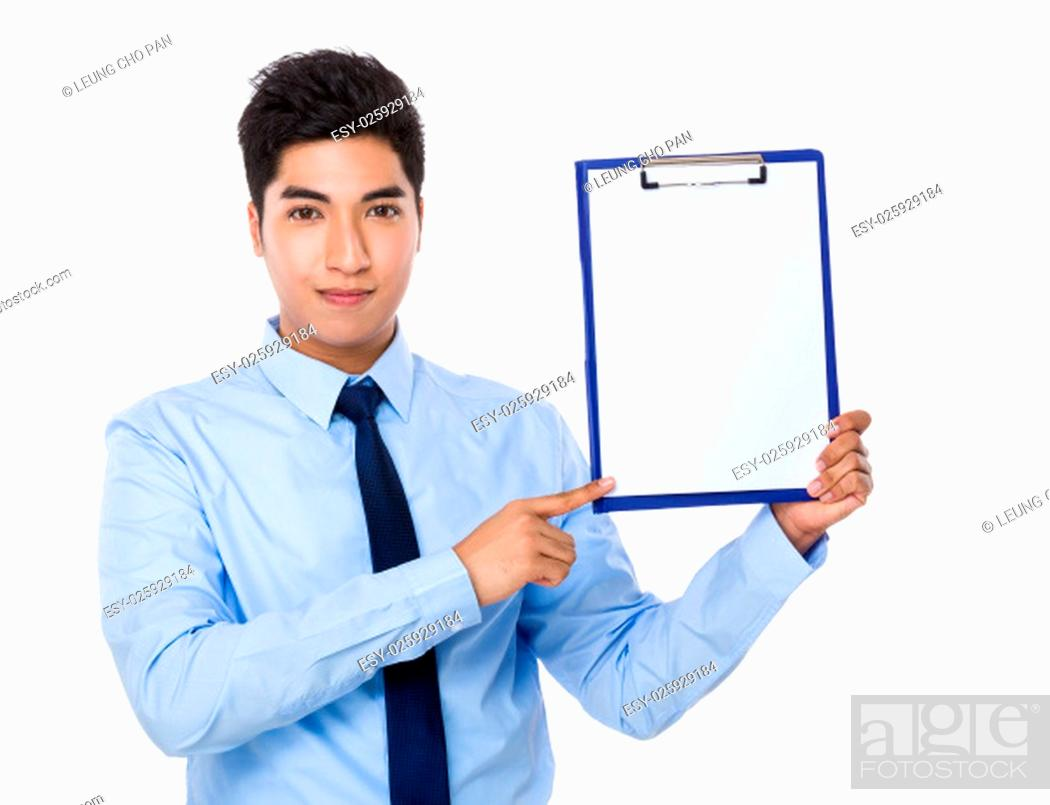 Stock Photo: Young businessman with finger point to clipboard.