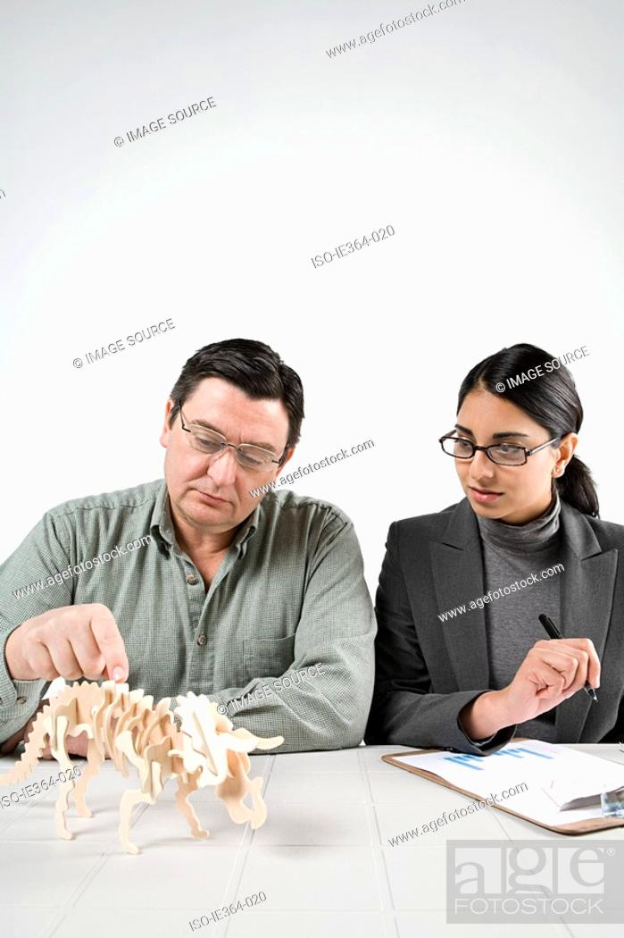 Stock Photo: Scientists with model dinosaur.