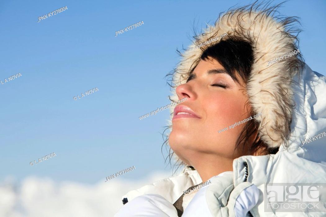 Stock Photo: Young woman enjoying winter sun.