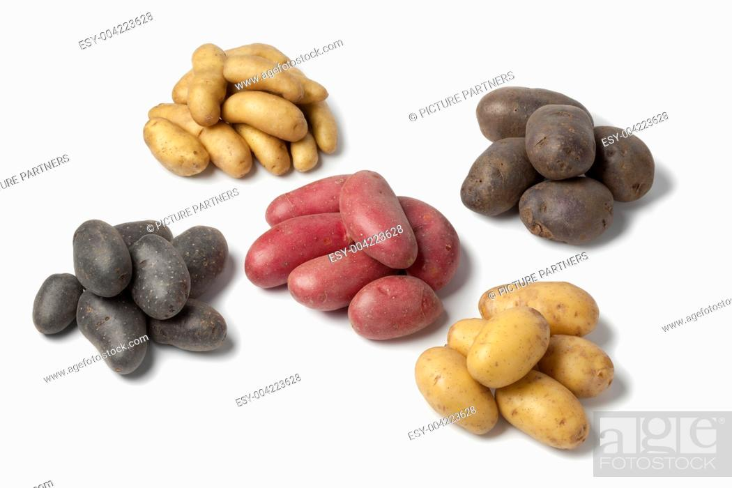Photo de stock: Variety of heirloom gourmet potatoes on white background.