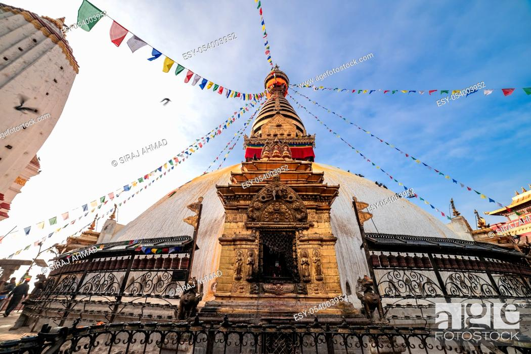 Stock Photo: Swayambhunath Stupa, aka The Monkey Temple, during sunrise in Kathmandu, Nepal. A UNESCO Heritage Site. Ancient ruins and stone temples.