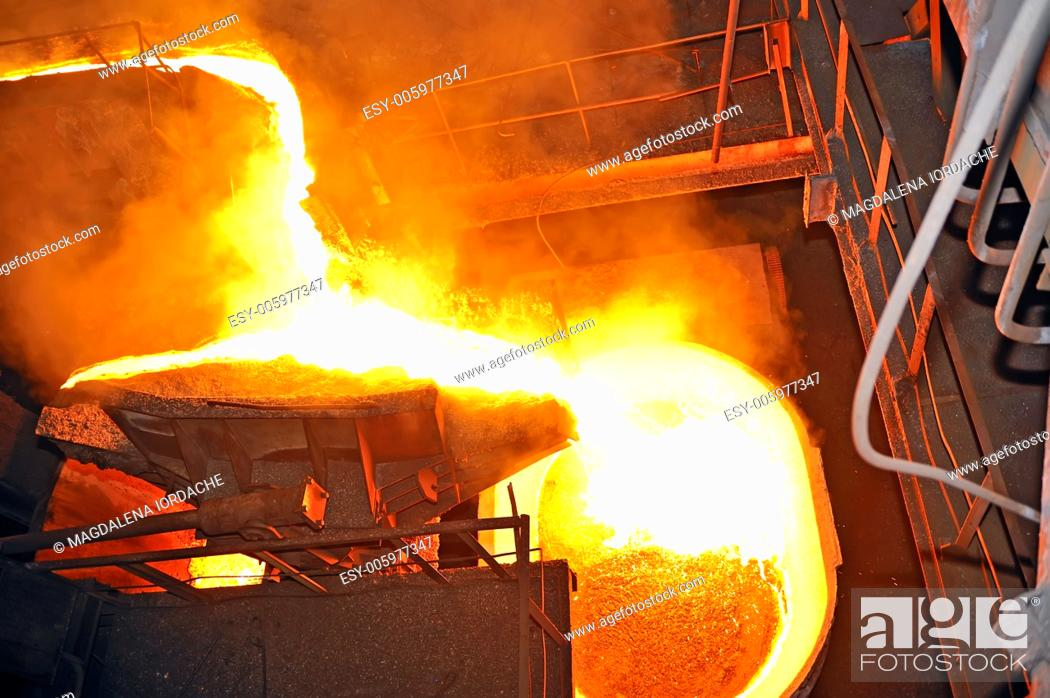 Stock Photo: pouring molten steel.
