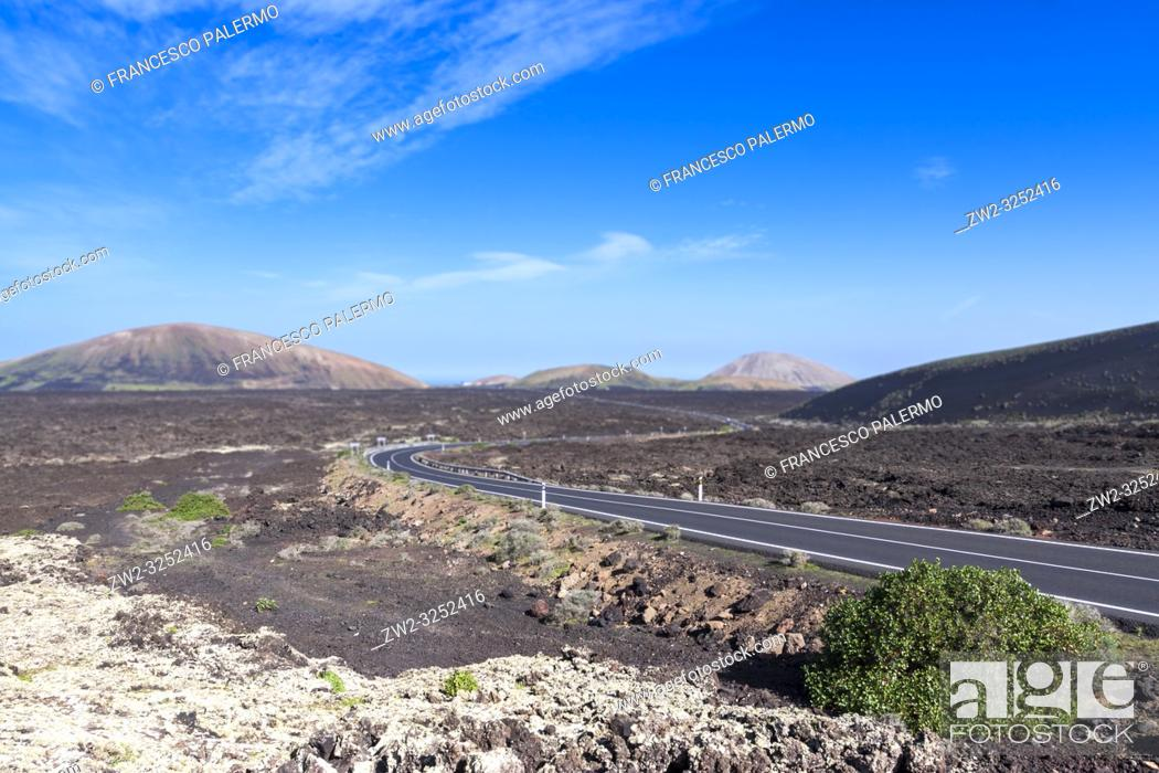 Stock Photo: The road between the volcanic lava. La Geria, Lanzarote. Spain.
