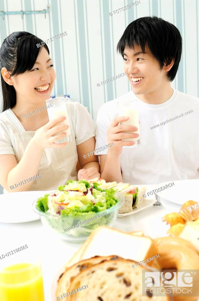 Stock Photo: Couple eating meal.