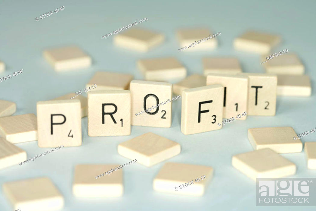 Stock Photo: Word build with single wooden tokens, selective focus.