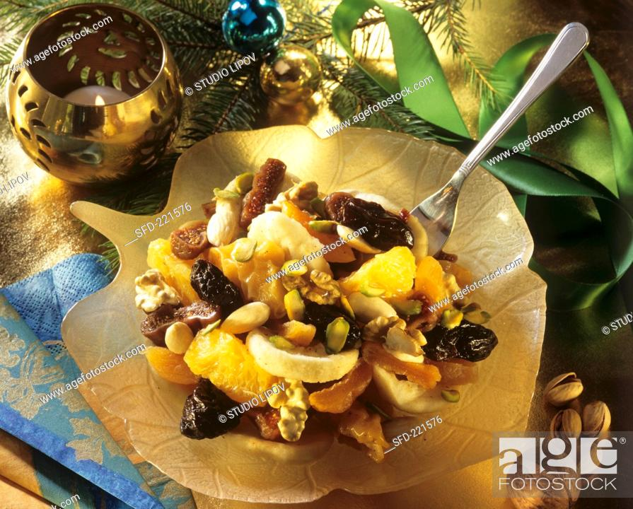 Stock Photo: Christmassy fruit salad with nuts and dried fruit.