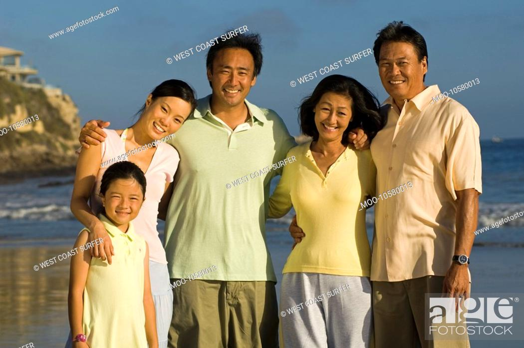 Stock Photo: Family with girl 7-9 on beach portrait.