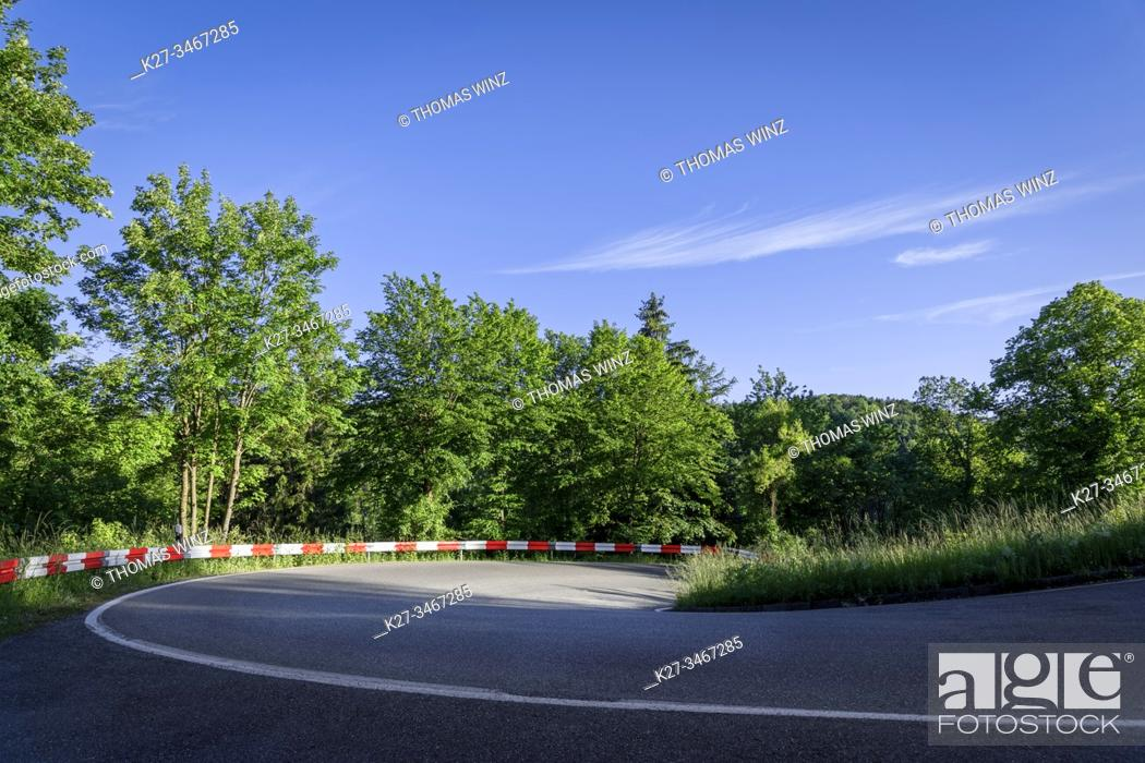Stock Photo: Curve with white and red guard rail, Baden Württemberg, Germany.