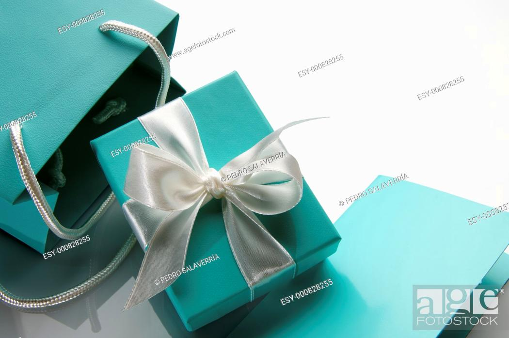 Stock Photo: small turquoise box tied with a white ribbon and bag.