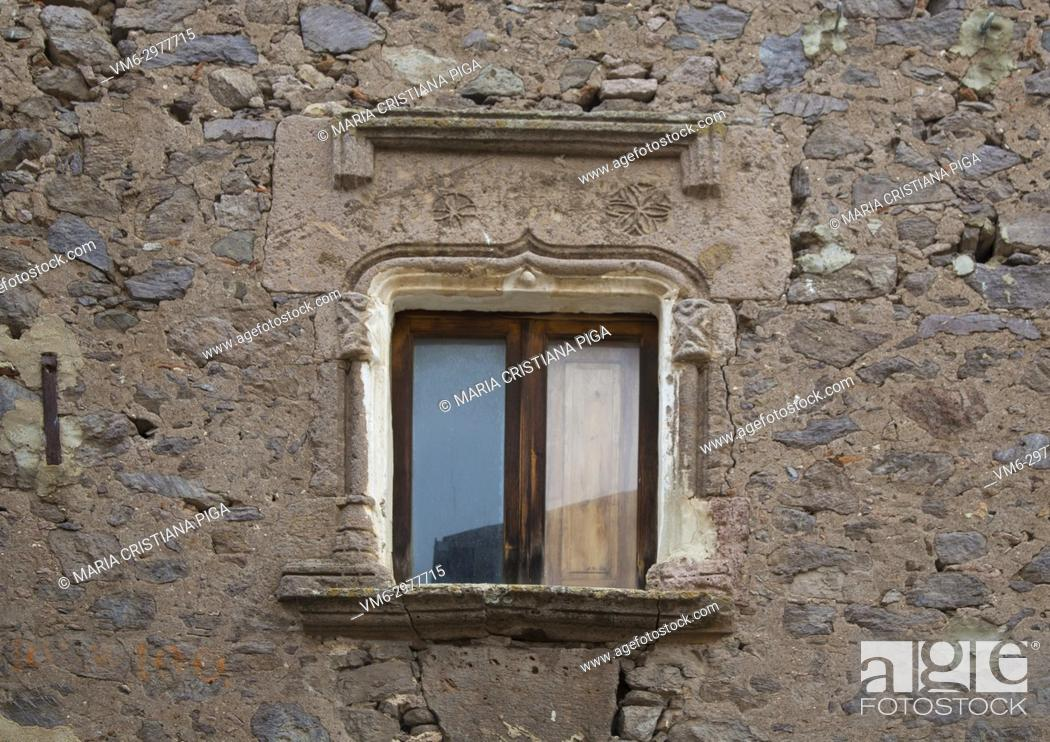 Stock Photo: an old window with a 15th century stone architrave in the old village of Bortigali, Sardinia, Italy.