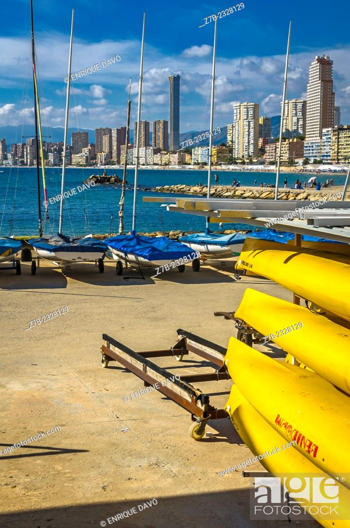 Stock Photo: Vertical view of a yellow canoes in Benidorm port, Alicante north, Spain.