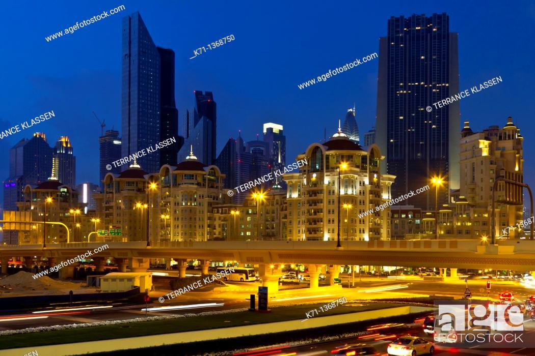 Stock Photo: The Dubai city skyline near the Dubai Mall at night, UAE.