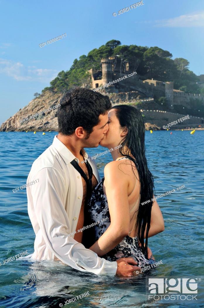 Stock Photo: Young couple on the beach, Tossa de Mar, Costa Brava, Girona, Spain, Europe.