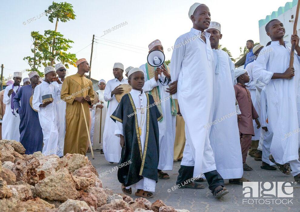 Stock Photo: Sunni muslim people parading during the Maulidi festivities in the street, Lamu County, Lamu Town, Kenya.