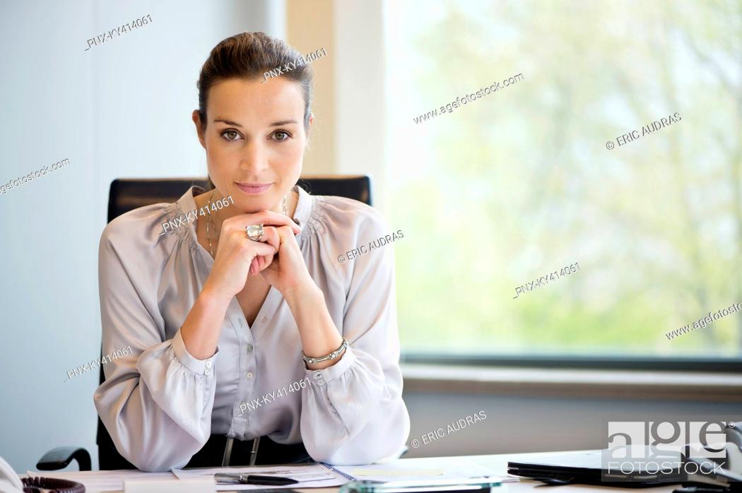 Stock Photo: Portrait of a businesswoman in an office.