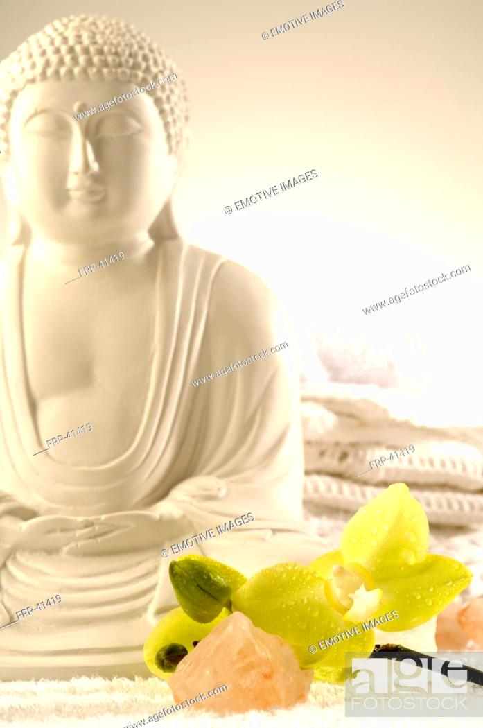 Stock Photo: Buddha with orchids and salt crystal.