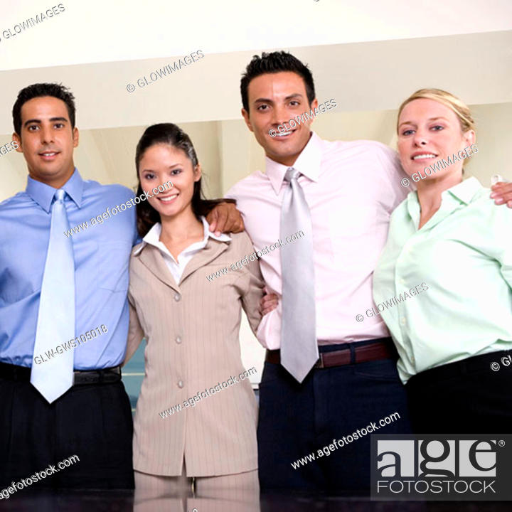 Stock Photo: Portrait of two businessmen and two businesswomen smiling.