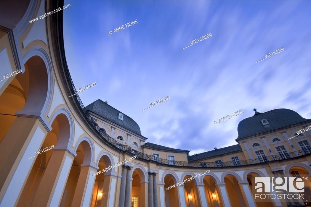 Stock Photo: Wide angle shot of atrium of Poppelsdorfer Schloss. At twilight, long exposure with moving clouds. Bonn, Germany.