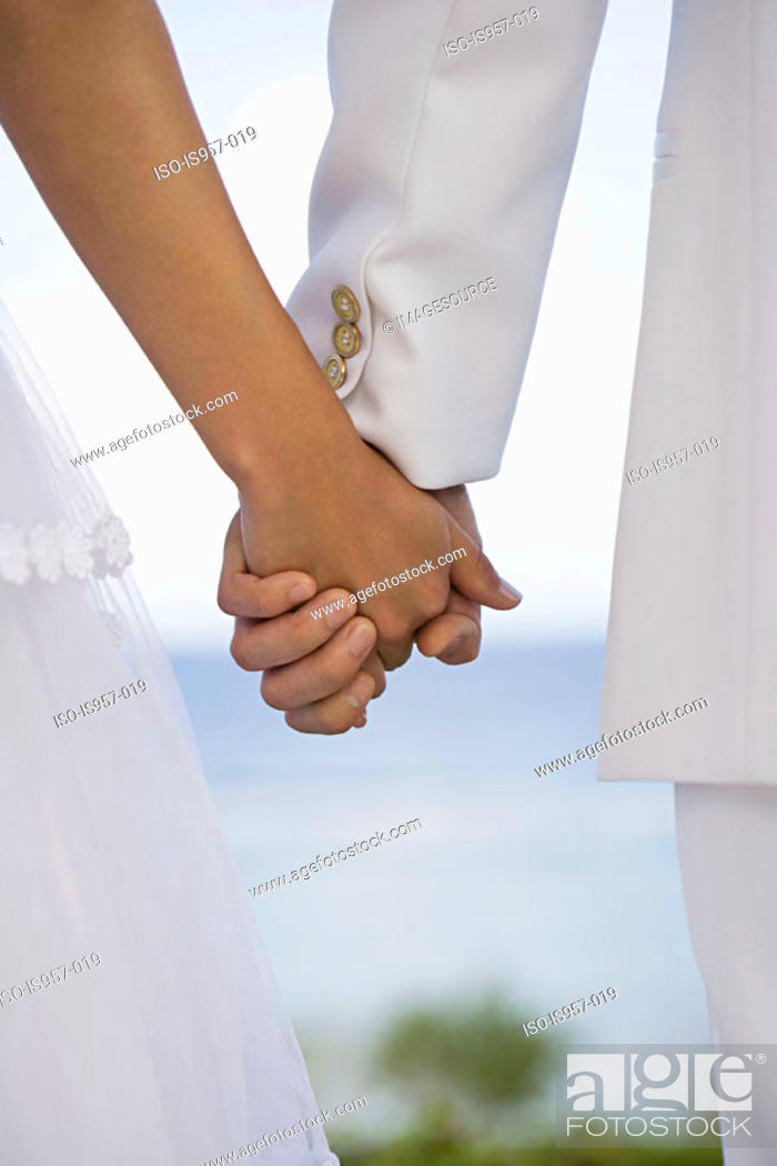 Stock Photo: Hands of bride and groom.