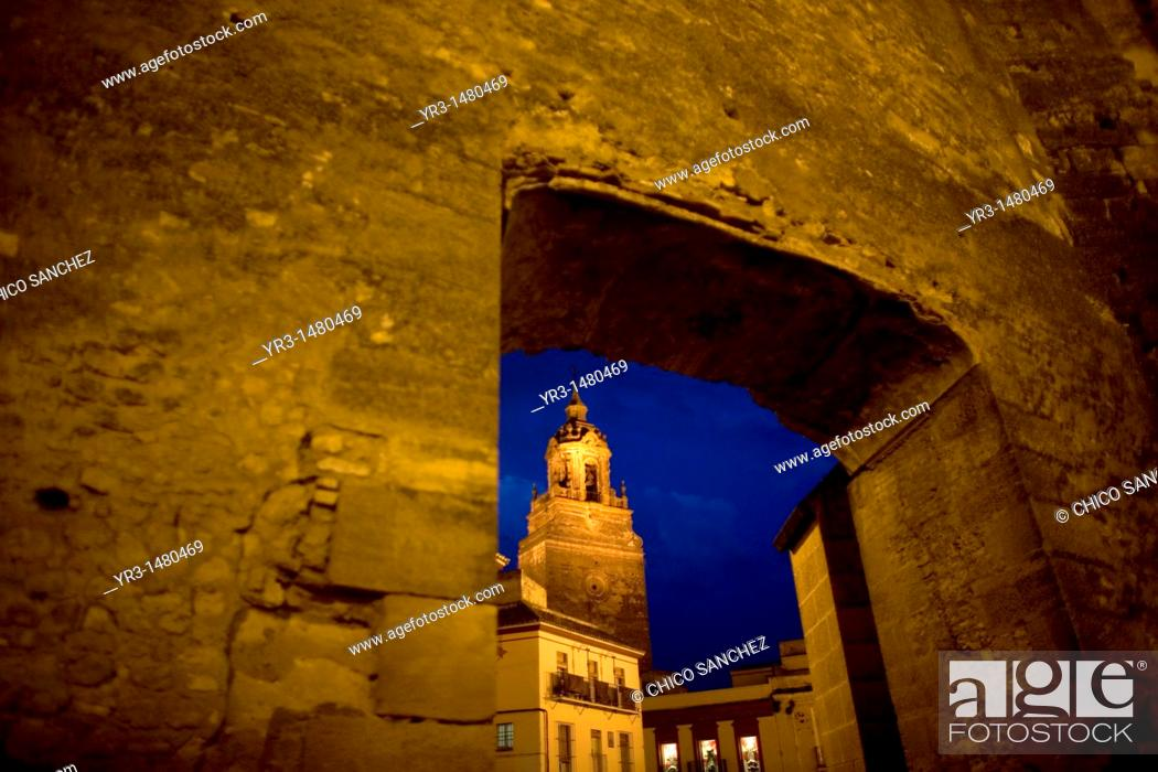 Stock Photo: The San Bartolome church is seen through a door of the Alcazar fortress in Carmona, Seville province, Andalusia, Spain, April 20, 2011.