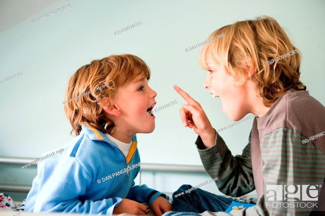 Stock Photo: Two young boys quarrelling.