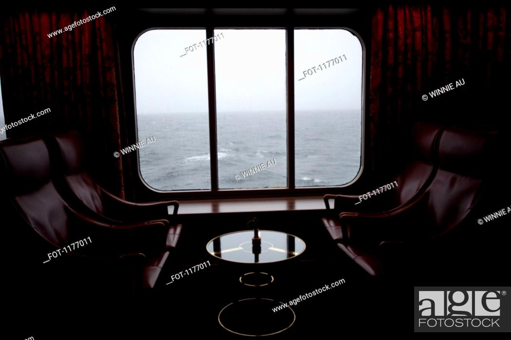 Stock Photo: View of Pacific Ocean through the window of lounge area on a passenger ship.